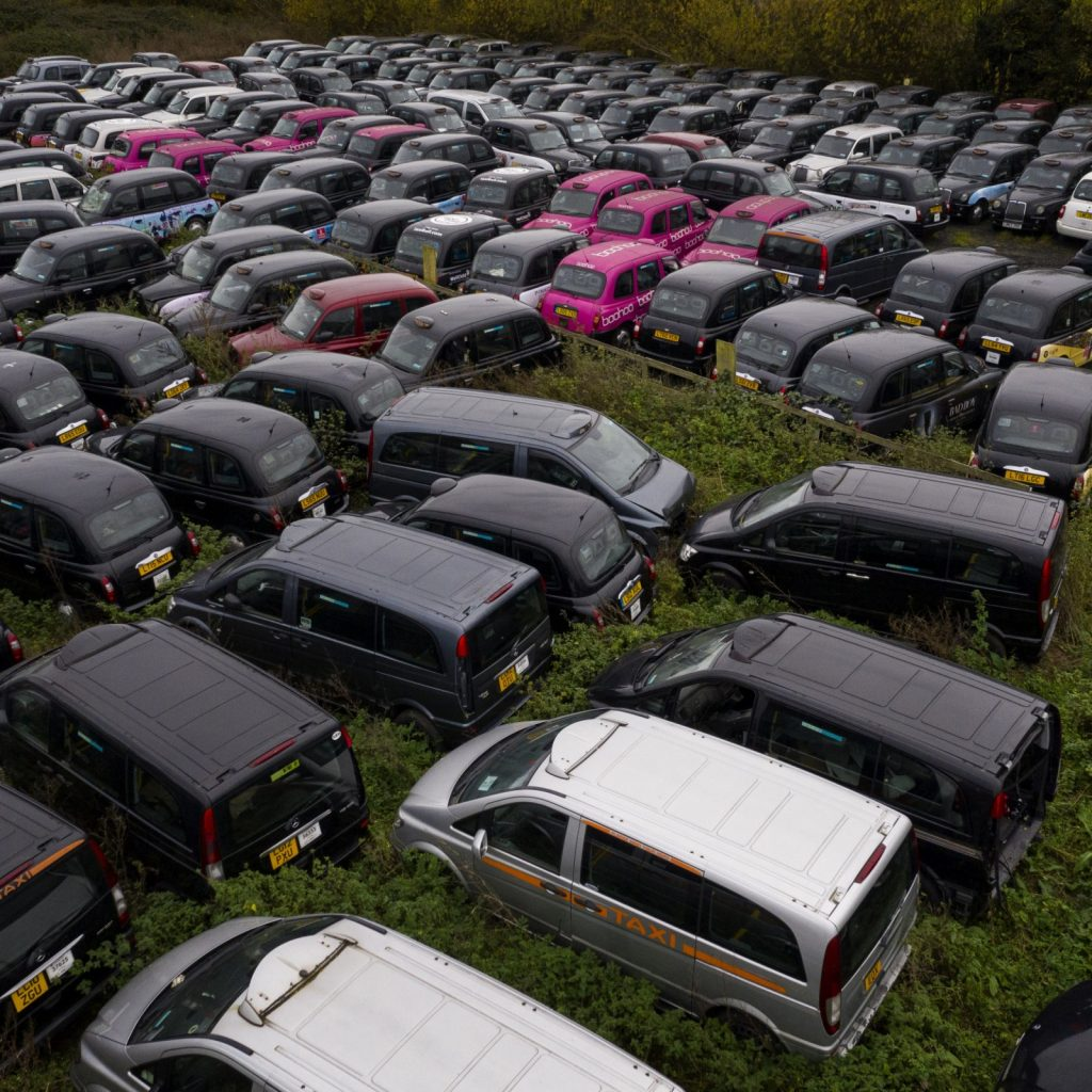 Black Cabs in London lie abandoned in field due to lack customer demand 1